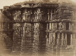 [Sculptural façade on the north-west elevation of the Hoysalesvara Temple, Halebid.]